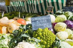 Multi-colored vegetables on Paris market stall with chalk price sign stock images