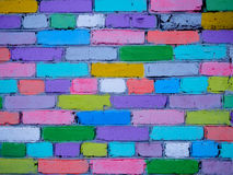 Multi-colored wall of bricks painted by children Stock Photo