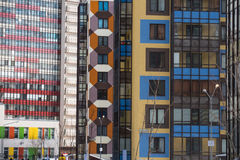 Multi-colored walls of apartment buildings. Stock Photos