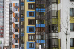 Multi-colored walls of apartment buildings. Royalty Free Stock Photo