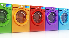 Multi colored washing machines  on white background. 3D illustration.  Stock Image