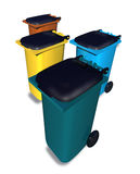 Multi colored waste bins. 3D render Illustration of waste disposal bins in different colors that environmental people use worldwide. Isolated in white background Royalty Free Stock Photography