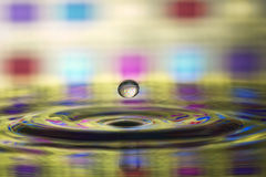Multi-colored water drop, splash Royalty Free Stock Images