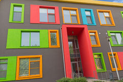 Multi-colored windows of the school in a contemporary style. Arc Stock Image