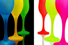 Multi-colored wine glasses on black and white background. Stock Photography