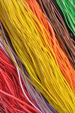 Multi-colored wires in computer networks Stock Photos
