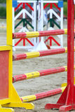 Multi colored wooden barriers on the ground for jumping horses and riders Stock Photo
