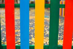 Multi-colored new wooden fence autumn. stock photos