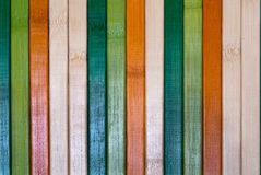 Multi colored wooden plank wall Stock Images