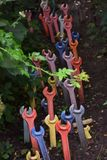 Multi-colored wrenches in the ground stock image