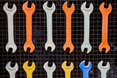 Multi-colored wrenches stock illustration