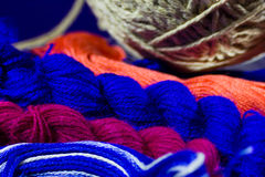 Multi-colored yarn and grey ball Royalty Free Stock Images