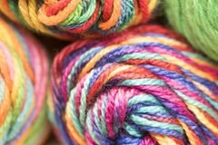 Multi-colored yarn. Several skeins of multicolored yarn stacked up Stock Photo