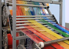Multi-colored yarns in the textile machine stock photos