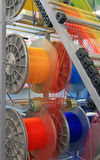 Multi-colored yarns in the textile machine Stock Photo
