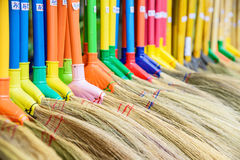 Multi colors dry grass broom, hand made from nature in Thailand. Royalty Free Stock Images