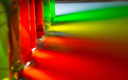 Multi colors light from bottle glass stock photography