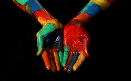 Multi Colors Oil Painted Hand Fist Close up praying gesture royalty free stock photography