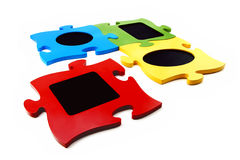 Multi-colour framework puzzle. On a white background Royalty Free Stock Image