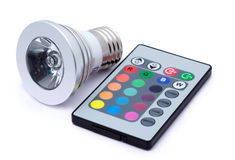 Multi colour LED light bulb and remote control Royalty Free Stock Images