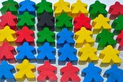 multi colour wooden human figures Stock Photo