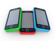 Multi-coloured 3D mobile phones Royalty Free Stock Image