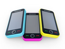 Multi-coloured 3D mobile phones Royalty Free Stock Images
