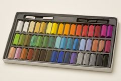 Artists pastels. Multi coloured artists pastel crayons in a box Stock Image
