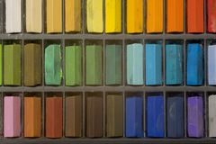 Artists pastels. Multi coloured artists pastel crayons pattern close up Stock Images