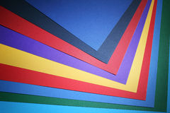 Multi Coloured Background. Shot of an array of fanned out vibrant coloured cards or paper Royalty Free Stock Photo