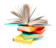 Multi-coloured books and open book. Royalty Free Stock Image