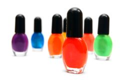 Multi-coloured bottles with nail polish. Stock Photography