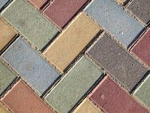 Coloured brick pavement Stock Images
