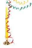 Multi-coloured celebratory tinsel and christmas candle. Multi-coloured celebratory streamer and christmas candle on a white background Stock Photos