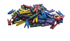 Multi-coloured clothes pegs. With copy space royalty free stock images