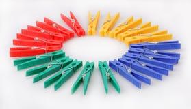 Multi-coloured clothespins Stock Photos