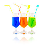 Multi-coloured cocktails in high glasses Royalty Free Stock Photography