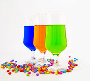 Multi-coloured cocktails in high glasses Stock Image