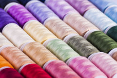 Multi-coloured cotton reels arts and crafts background. Multi-coloured cotton reels for use in art and crafts or textile industry backgrounds stock images
