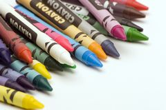 Multi Coloured Crayons. Set against a plain backgrund Royalty Free Stock Photography