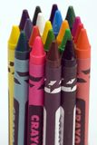 Multi Coloured Crayons. Set against a plain backgrund Stock Photos
