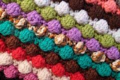Multi-coloured crochet bobble stitches diagonal stripes backgrou. Multi-coloured crochet bobble stitches in diagonal stripes, soft yarn abstract background Stock Images