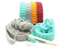 Multi-coloured crochet-work. Multi coloured crochet work with needle royalty free stock photos