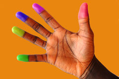 Multi coloured (cultured) finger tips 3. This is an image of a black hand with various different coloured finger tips. Brown/orange royalty free stock photo