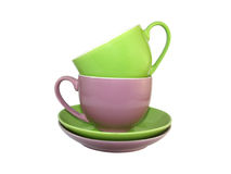 Multi-coloured cups 2. Set of amusing ware: multi-coloured cups and saucers Stock Images