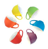 Multi-coloured cups. Set of amusing ware: multi-coloured cups located on a circle Royalty Free Stock Photos