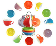 Multi-coloured cups and saucers. Set of amusing ware: multi-coloured cups and saucers Stock Images