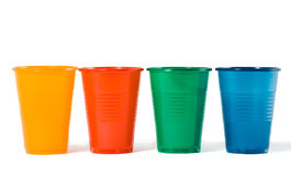 Multi-coloured disposable plastic glasses Stock Photos