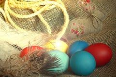 Multi-coloured Easter eggs. On desktop royalty free stock photo