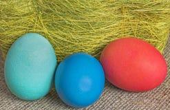 Multi-coloured Easter eggs. On desktop stock image